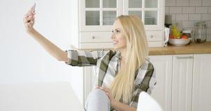 Lovely female taking selfie Royalty Free Stock Image