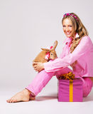 Lovely festive woman with a rabbit Stock Photography