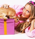 Lovely festive woman with a rabbit Royalty Free Stock Image