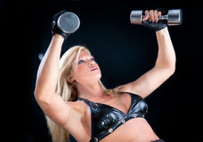 Lovely fitness instructor with dumbbells Royalty Free Stock Photos