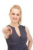 Lovely fitness instructor pointing her finger Stock Images