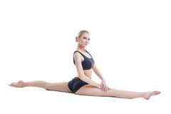 Lovely flexible girl posing sitting on splits Royalty Free Stock Photo