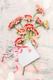 Lovely flowers bouquet with blank white card ,bow and bokeh on shabby chic background Royalty Free Stock Images