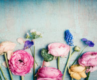 Lovely flowers retro pastel toned on vintage turquoise background. Top view royalty free stock images