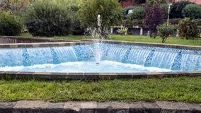 A lovely fountain with small waterfalls and blue tile on a street in Sorrento, Italy. Pictured is a lovely fountain with small waterfalls and blue tile on a Stock Image