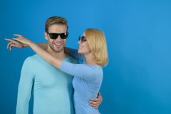 Lovely and friendly. Friendship day. Couple in love. Couple of man and woman wear fashion glasses. Fashion models in. Lovely and friendly. Friendship day. Couple royalty free stock image