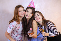 Lovely friendly girls celebrate birthday of their female friends Royalty Free Stock Photo