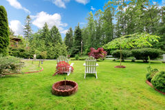 Lovely front lawn with two chairs. Royalty Free Stock Images