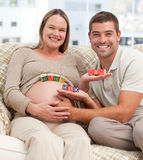 Lovely future parents holding cubes Stock Images