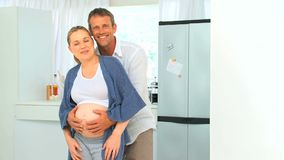 Lovely future parents looking at the camera Royalty Free Stock Photos