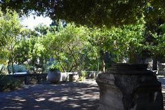 Shady Garden in the backstreets of Rhodes Walled Town stock images