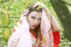 Lovely geisha in red kimono Royalty Free Stock Photography
