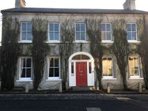 Lovely Georgian House with red door stock photos