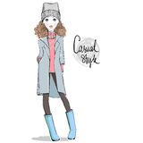 Lovely girl in autumn-winter clothes. Royalty Free Stock Images
