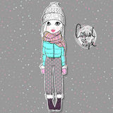 Lovely girl in autumn-winter clothes. Royalty Free Stock Image