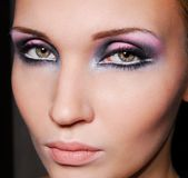 Lovely girl with beautiful eye. Beautiful face. Black-violet make-up of eyes. Green eyes stock photos