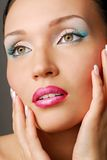 Lovely girl with beautiful eye. Beautiful face. Blue make-up for eyes. Green eyes stock photography
