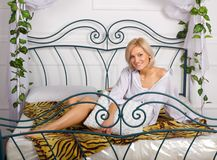 Lovely girl on the bed Royalty Free Stock Photos