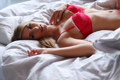 Lovely girl in bed Royalty Free Stock Images