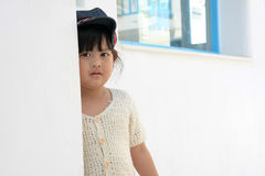 Lovely girl. Behind wall see beautiful girl Royalty Free Stock Images