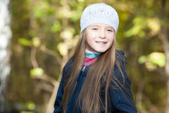 Lovely girl in a beret in the forest Royalty Free Stock Photo