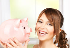 Lovely girl with big piggy bank. Picture of lovely girl with big piggy bank Royalty Free Stock Photos