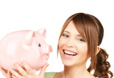 Lovely girl with big piggy bank. Picture of lovely girl with big piggy bank Stock Photo