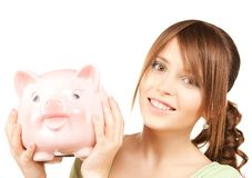 Lovely girl with big piggy bank. Picture of lovely girl with big piggy bank Royalty Free Stock Photo