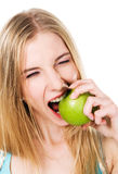 Lovely girl biting an apple Royalty Free Stock Images