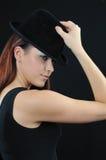 Lovely girl in black bonnet Stock Photography