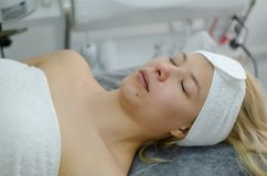 Cosmetic facial treatment stock photography