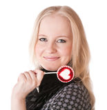 Lovely girl blonde with lollipop Royalty Free Stock Photos