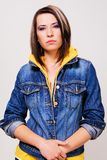 Lovely girl in a blue denim jacket Royalty Free Stock Images