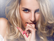 Lovely girl with blue eyes. On smokie background Royalty Free Stock Photo