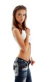Lovely girl in blue jeans and Royalty Free Stock Photo
