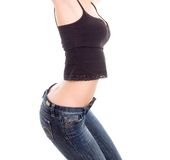 Lovely girl in blue jeans crouch down low. Lovely girl in blue jeans and black shirt crouch down low Royalty Free Stock Photo