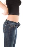Lovely girl in blue jeans undress the shirt Stock Photo
