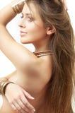 Lovely girl in bronze bracelets stock image