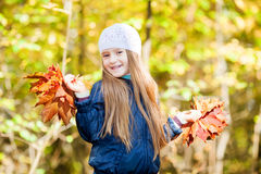 Lovely girl  with a bunch of leaves Royalty Free Stock Image