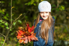 Lovely girl  with a bunch of leaves Stock Photography