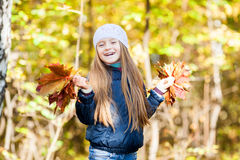 Lovely girl  with a bunch of leaves Stock Photo