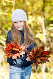 Lovely girl  with a bunch of leaves Stock Images