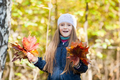 Lovely girl  with a bunch of leaves Stock Image
