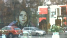 Lovely girl in a cafe. stock footage