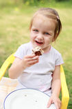 Lovely girl with cake Stock Images