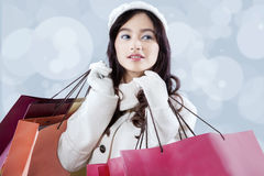 Lovely girl carrying shopping bags Stock Photo