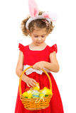 Lovely girl checking Easter eggs Stock Images