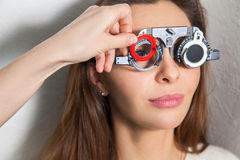 Lovely girl checks vision in an ophthalmologist with corrective Stock Image