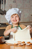 Lovely girl in a chef's hat cooking sweet cake Royalty Free Stock Images