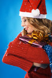 Lovely girl with Christmas gift Stock Images